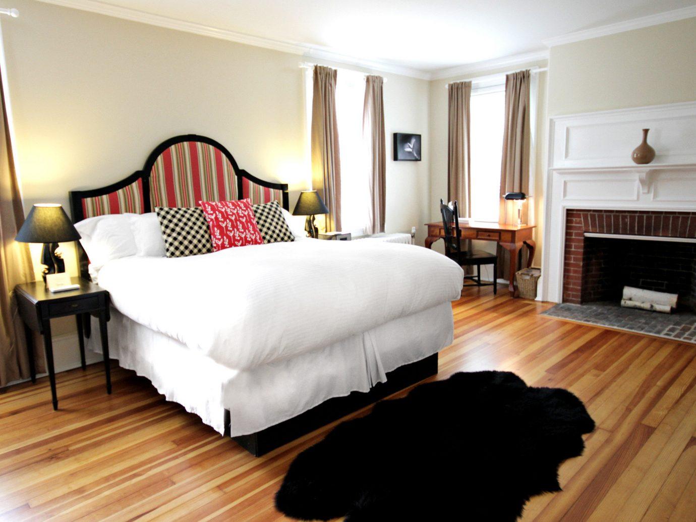 Bedroom Classic Country Inn Suite floor indoor wall room Living ceiling property wood furniture hardwood cottage interior design estate real estate bed wood flooring rug hard flat