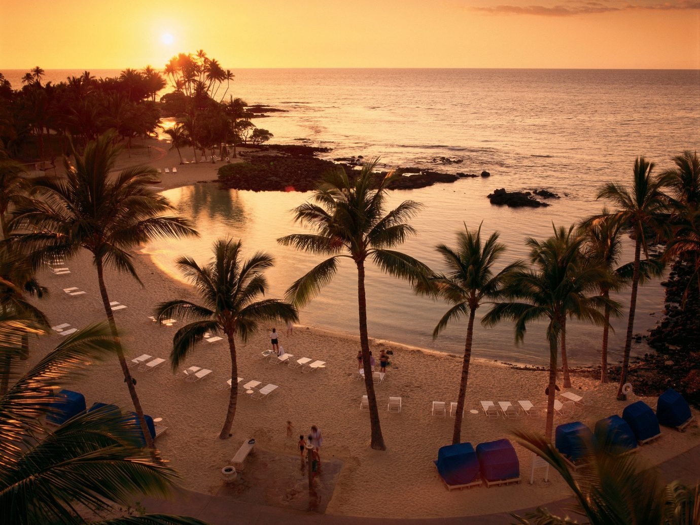 Jetsetter Guides sky outdoor Sunset Sun Ocean plant Sea tree Beach sunrise evening morning arecales Coast dusk sunlight dawn sand tropics bay palm wave shore setting