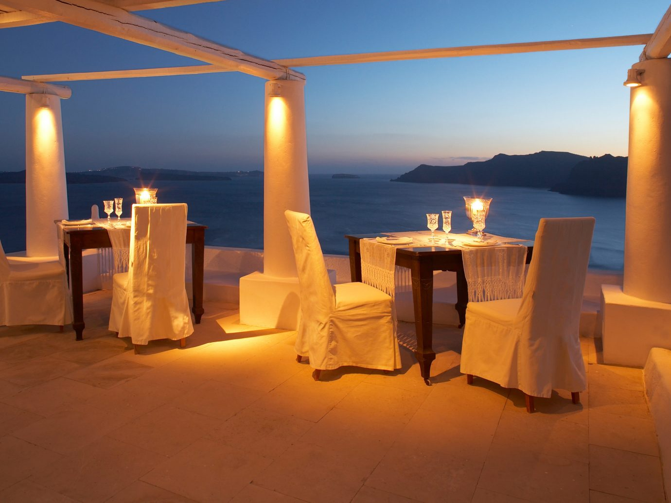 Beachfront Dining Drink Eat Greece Hotels Ocean Romantic Santorini Sunset sky outdoor light evening lighting shape restaurant