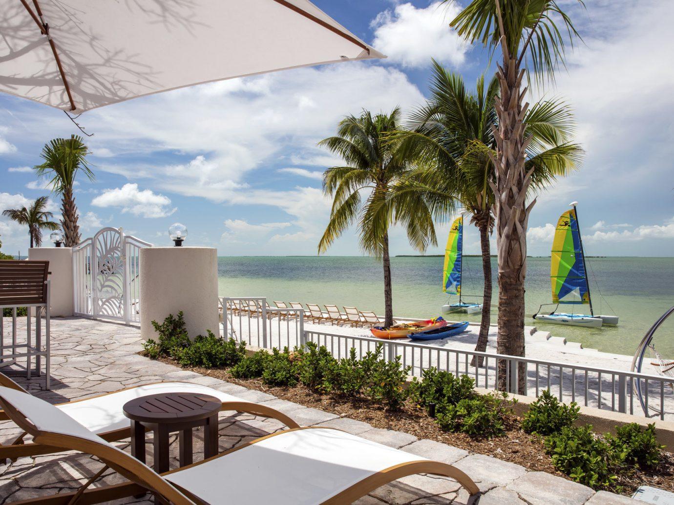 Florida Miami Trip Ideas Weekend Getaways tree outdoor sky leisure property palm vacation estate caribbean Resort home arecales Beach Villa swimming pool area furniture several