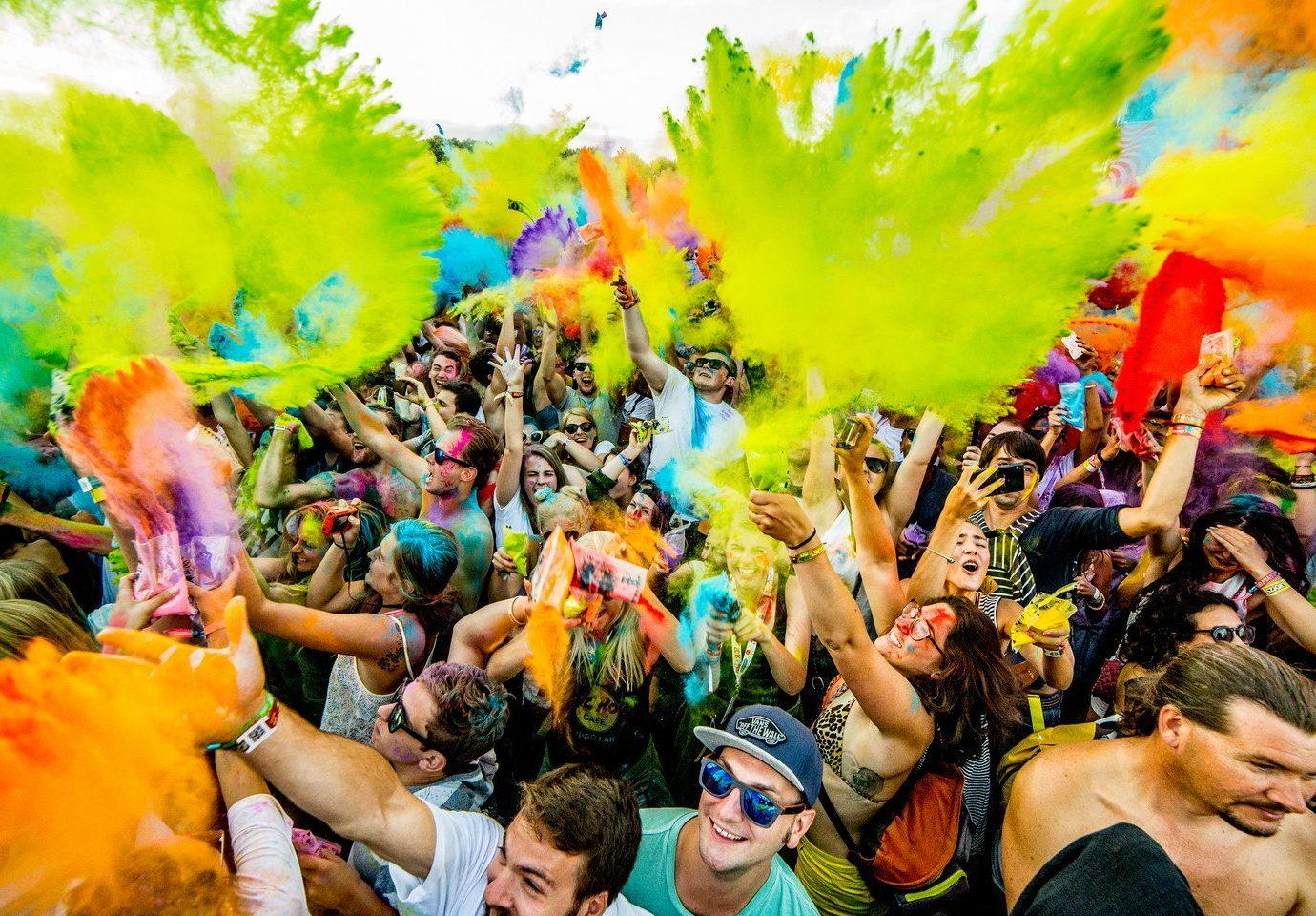 Arts + Culture person color crowd people colorful carnival festival event colored