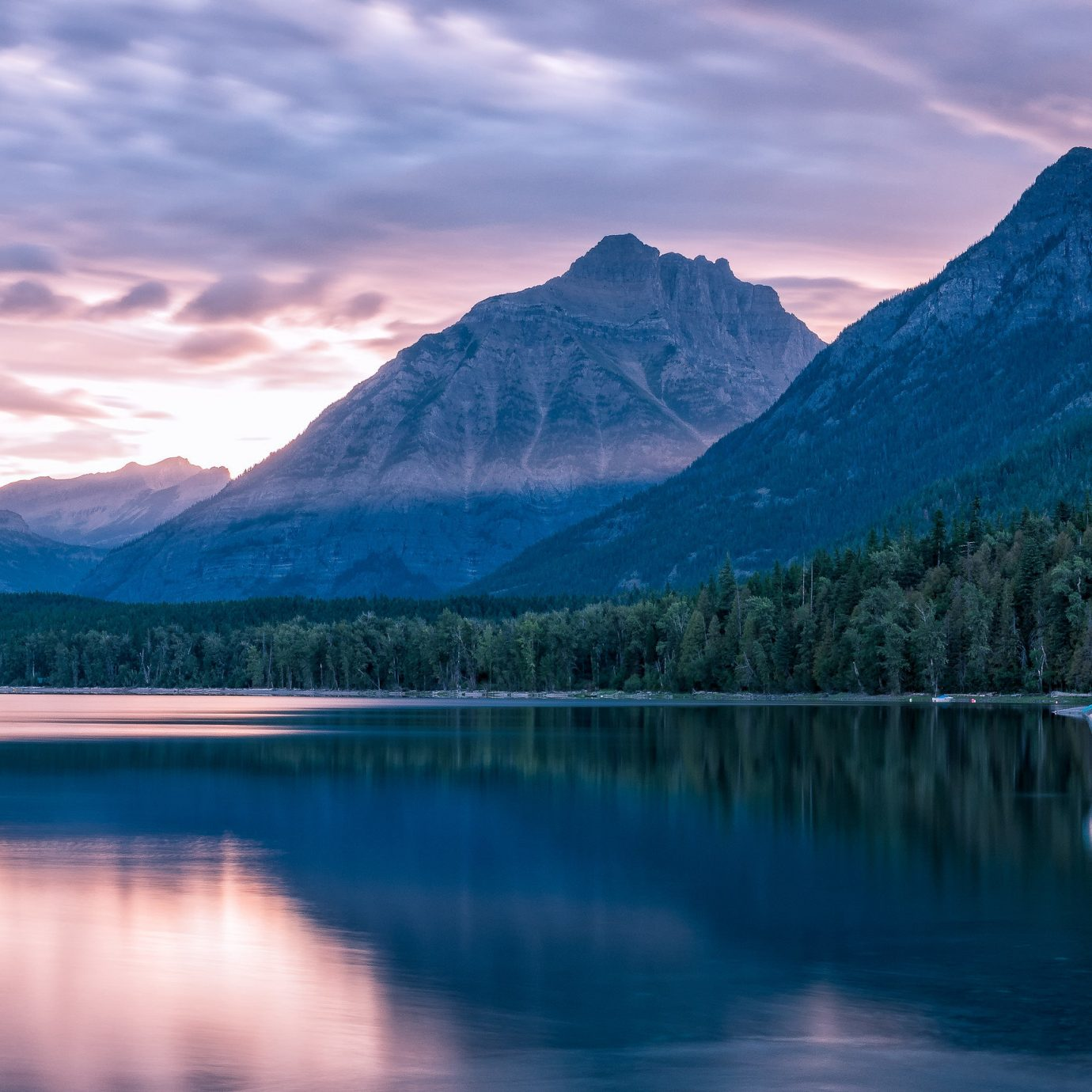 Lakes + Rivers Outdoors + Adventure Trip Ideas mountain water sky outdoor mountainous landforms Boat Nature reflection Lake landform wilderness body of water mountain range fjord cloud loch morning canyon landscape glacial landform alps reservoir dusk surrounded distance