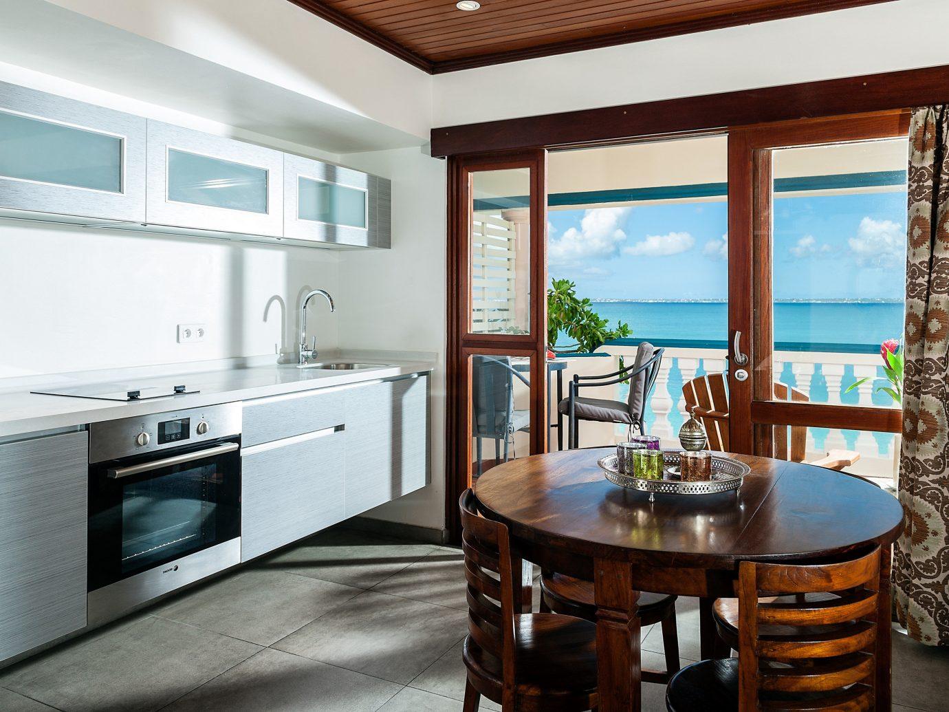 Hotels indoor floor window interior design Kitchen ceiling real estate countertop interior designer cuisine classique furniture wood Island