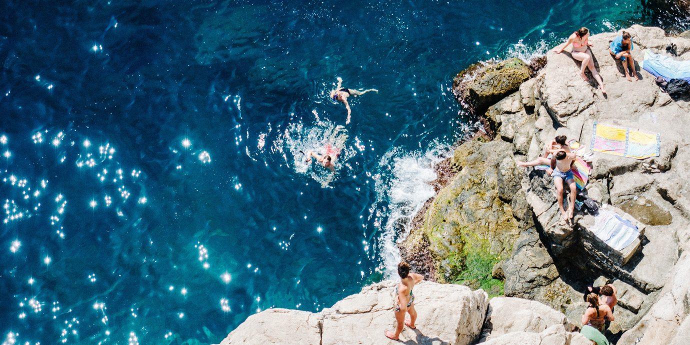 Travel Tips Trip Ideas rock outdoor geological phenomenon screenshot extreme sport terrain underwater swimming