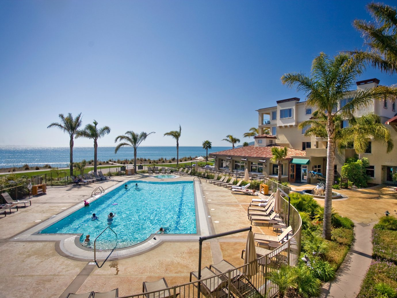 Hotels sky outdoor ground swimming pool property leisure Resort estate vacation Beach Villa real estate caribbean condominium lined Deck shore sandy