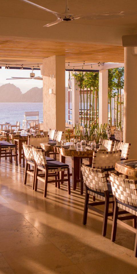 Budget Hotels Travel Tips indoor table floor ceiling window restaurant Dining room meal function hall estate interior design furniture wood Bar Island several