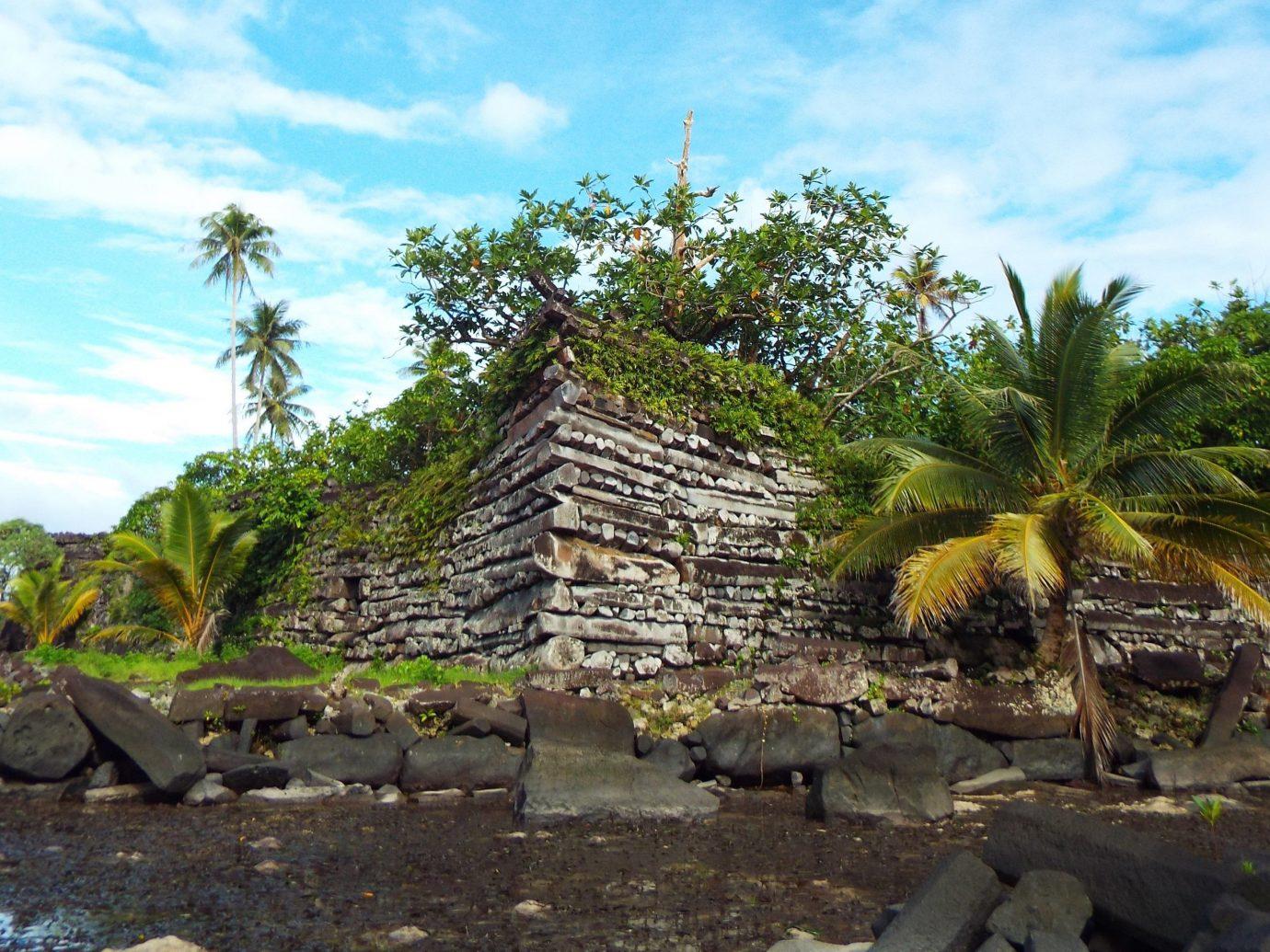 Trip Ideas tree outdoor sky archaeological site rock arecales vacation Ruins Jungle Coast tropics Resort palm family plant hut Village stone shade