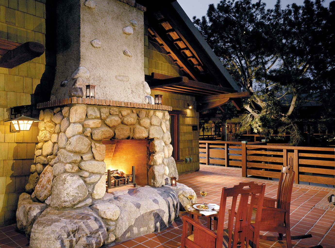 Hotels Living Lounge Luxury Rustic outdoor house log cabin home cottage wood estate backyard area stone furniture
