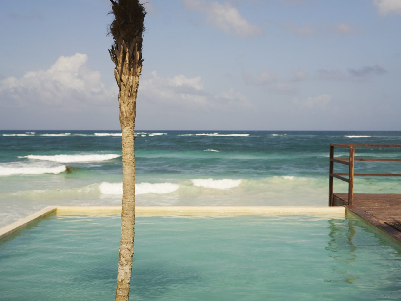 Boutique Hotels Hotels Mexico Tulum water sky outdoor Sea body of water shore tropics caribbean arecales palm tree Ocean Beach coastal and oceanic landforms plant vacation tree Coast Nature Resort swimming pool horizon palm Lagoon bay cloud overlooking Island sandy
