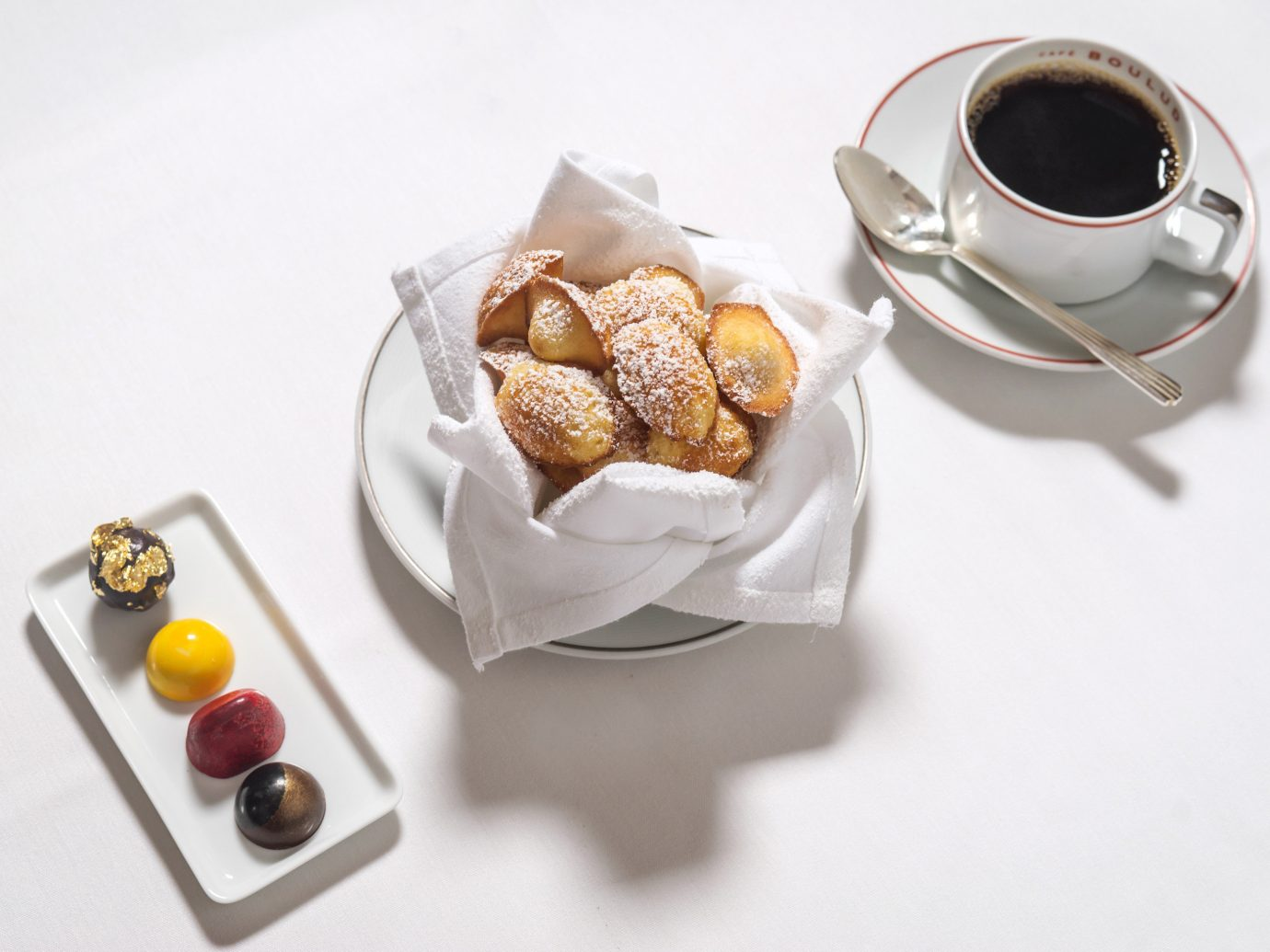 Food + Drink table cup plate food pastry dessert meal produce praline chocolate tray
