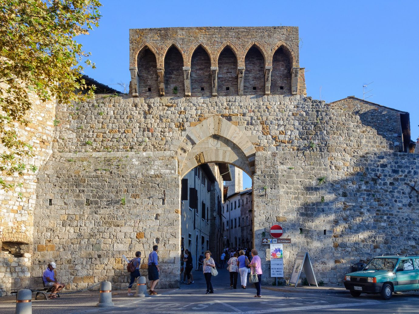 Italy Trip Ideas wall historic site medieval architecture building history sky arch fortification City facade abbey tree middle ages ancient history tourism tours Church