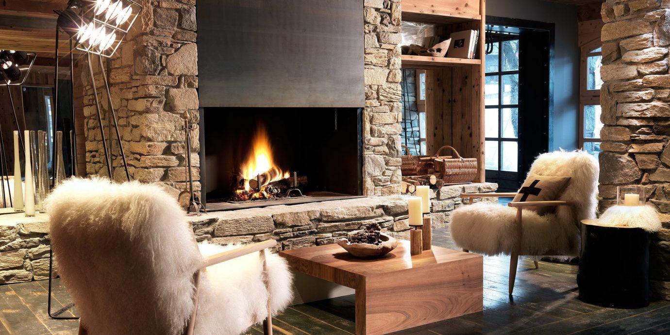 Hotels Fireplace indoor floor hearth living room Living building room home wood house interior design flooring cottage stone furniture