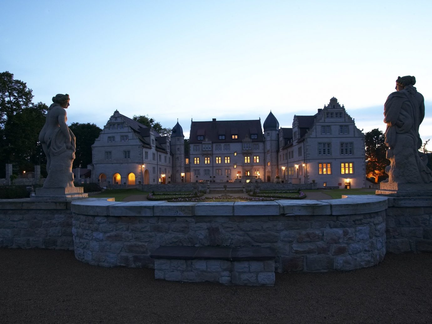 Hotels Landmarks Luxury Travel sky outdoor château water evening reflection wall building morning estate castle tourist attraction mansion tree historic site tours tourism dusk landscape stately home