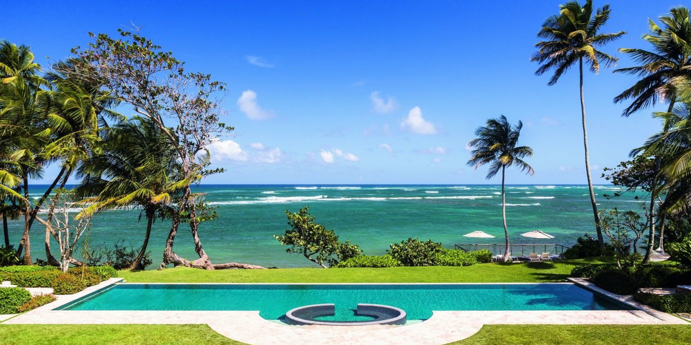 Hotels Trip Ideas tree sky grass outdoor leisure property swimming pool Resort estate vacation palm caribbean Villa Golf arecales bay mansion Beach lawn overlooking shade