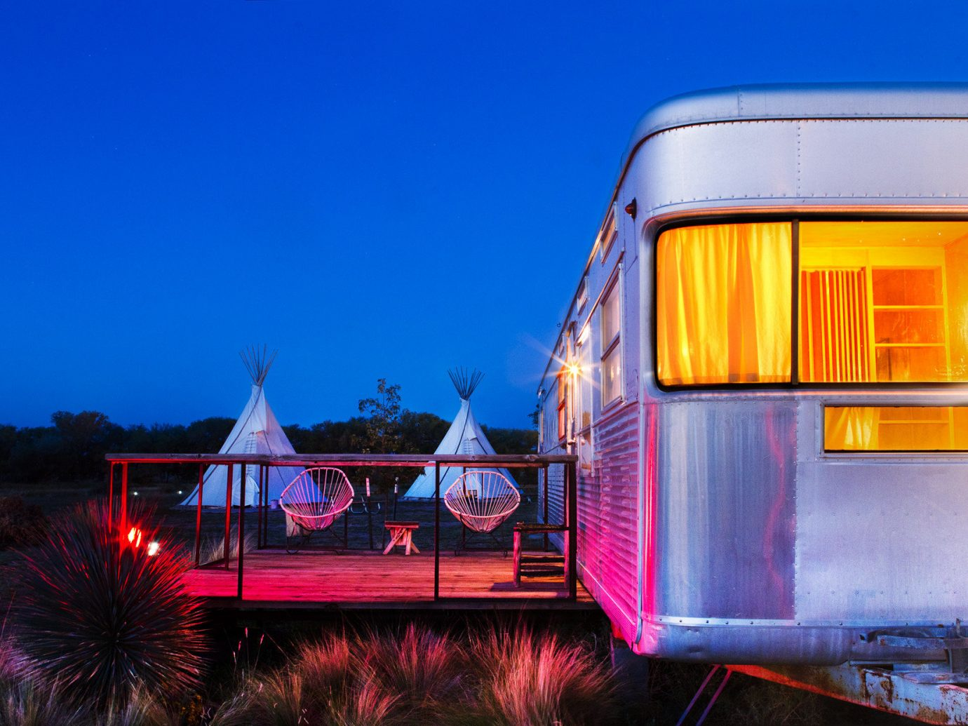 airstream ambient lighting artistic artsy calm Exterior Glamping Hip isolation Luxury Travel night Night Sky Patio porch quirky remote serene Terrace trendy Trip Ideas sky outdoor transport vehicle light evening