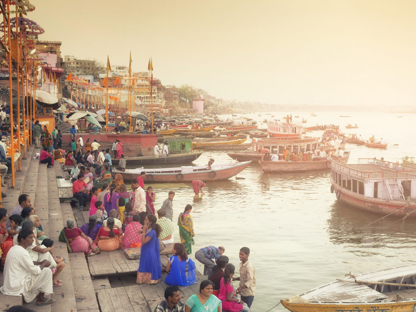 India Jaipur Jodhpur Trip Ideas outdoor waterway body of water person water transportation water tourism City sky people Sea temple group boating recreation vacation River leisure several