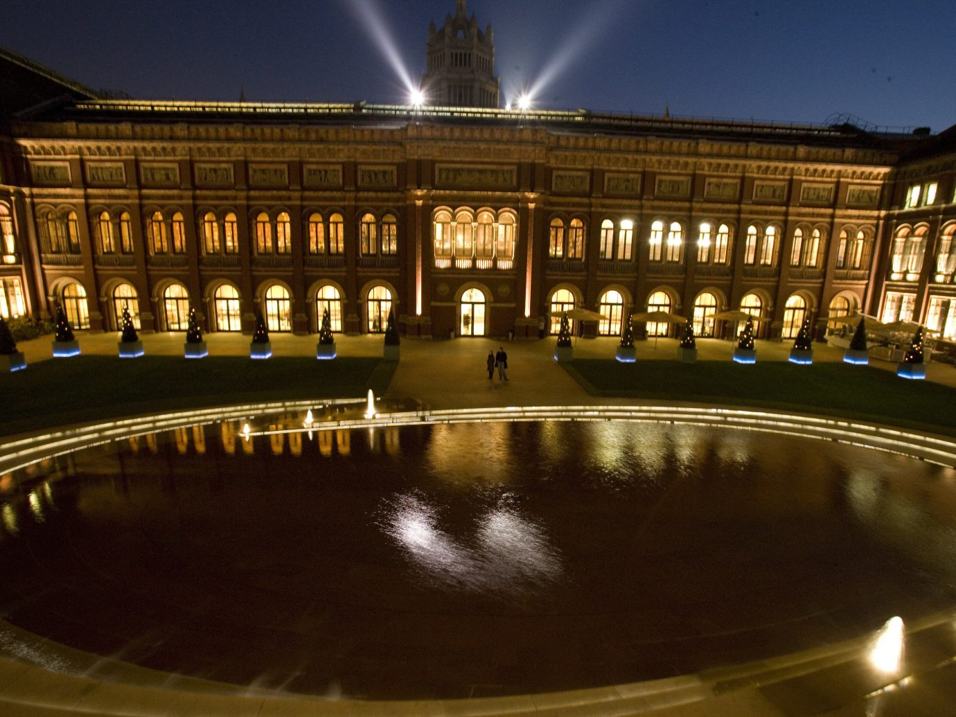 Arts + Culture Trip Ideas reflection water landmark night light tourist attraction City plaza town square metropolis building water feature fountain evening reflecting pool symmetry estate