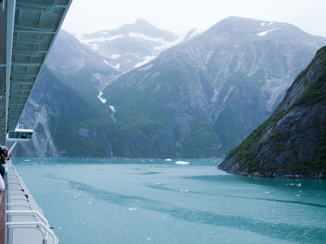 Trip Ideas mountain outdoor water sky Boat landform geographical feature fjord Nature glacial landform vehicle Sea passenger ship mountain range bay glacier surrounded distance