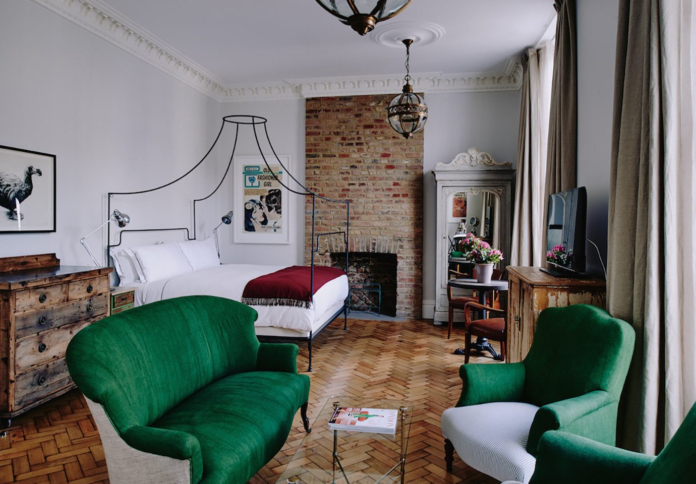 Boutique Hotels Hotels Living sofa indoor room wall floor green chair living room interior design furniture home real estate leather Suite house ceiling estate interior designer rug table area decorated