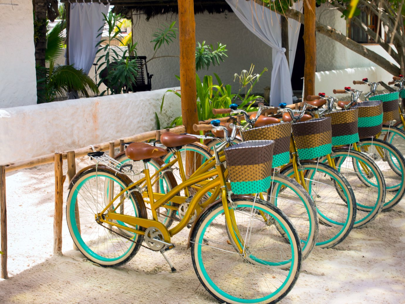 Beach Outdoor Activities Play Secret Getaways Trip Ideas outdoor bicycle ground vehicle parked colorful yellow sports equipment cart rack