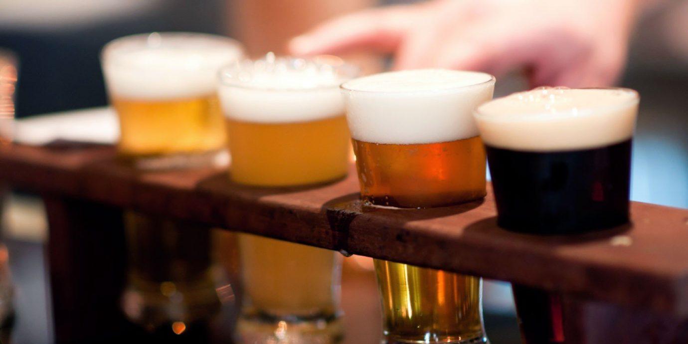Food + Drink cup table coffee indoor beer alcoholic beverage Drink alcohol lighting restaurant Bar sense