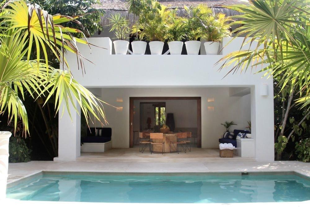 Beach Honeymoon Hotels Mexico Romance Tulum property estate home house Villa real estate Resort swimming pool palm tree arecales hacienda facade interior design