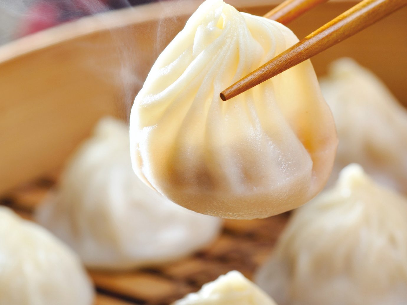 Food + Drink food dish xiaolongbao plate khinkali cuisine indoor chinese food dessert asian food dumpling dim sum pastry meal momo flavor