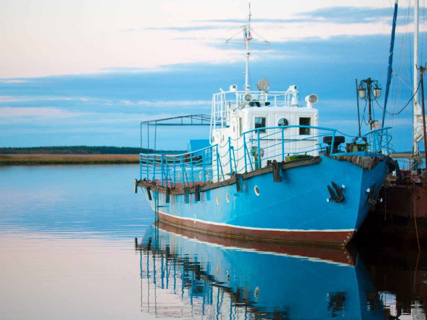 Secret Getaways Travel Tips water water transportation waterway Boat reflection fishing vessel sky Sea motor ship watercraft Harbor ship marina