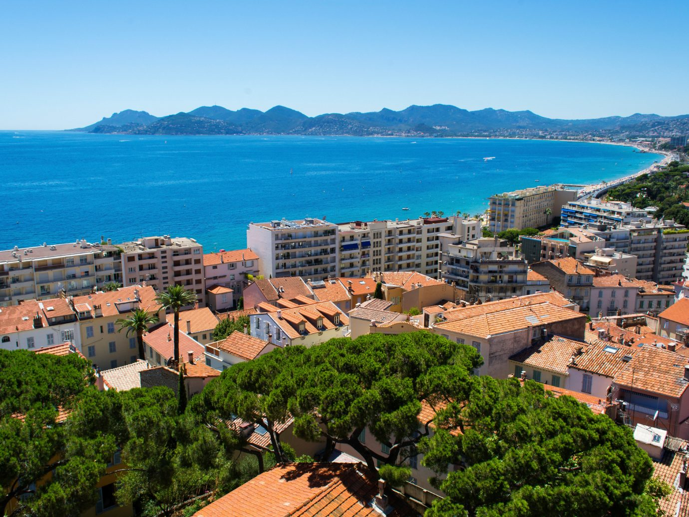 Beach Budget Scenic views sky outdoor mountain Town geographical feature Coast Sea human settlement vacation aerial photography overlooking residential area cityscape landscape bay Village City beautiful roof traveling hillside