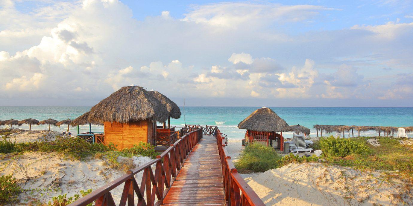 Hotels Trip Ideas sky outdoor pier Sea shore Coast Beach body of water Ocean vacation wooden bay tourism cove Island Resort cape