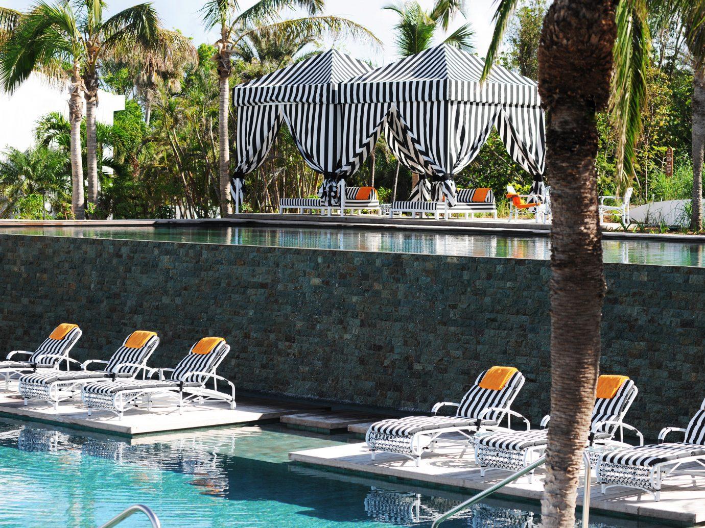 Beach Beachfront Deck Island Lounge Pool Scenic views Trip Ideas Waterfront tree leisure outdoor swimming pool Resort