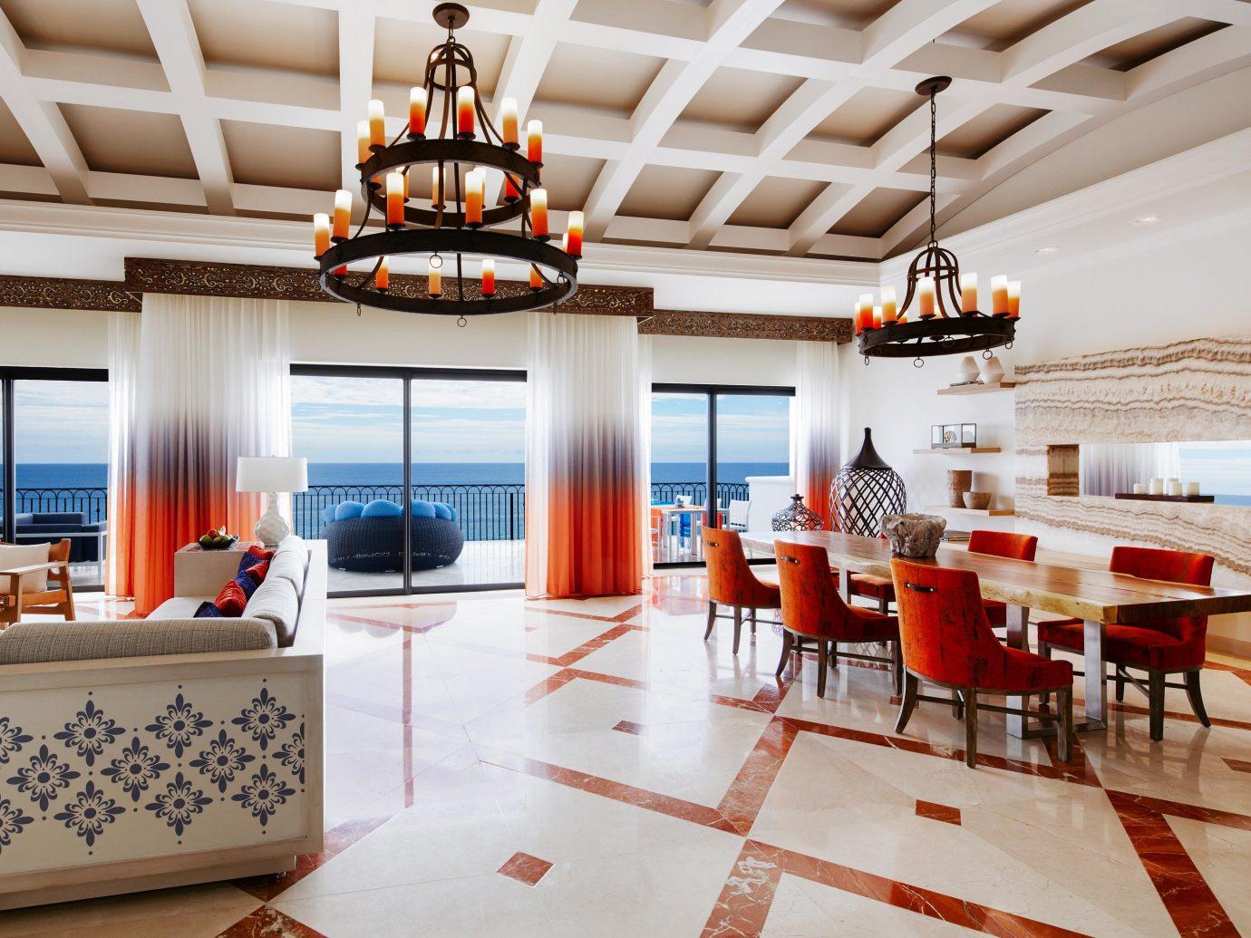 Budget Hotels indoor floor ceiling room property Living restaurant Resort estate interior design Design real estate home orange furniture several
