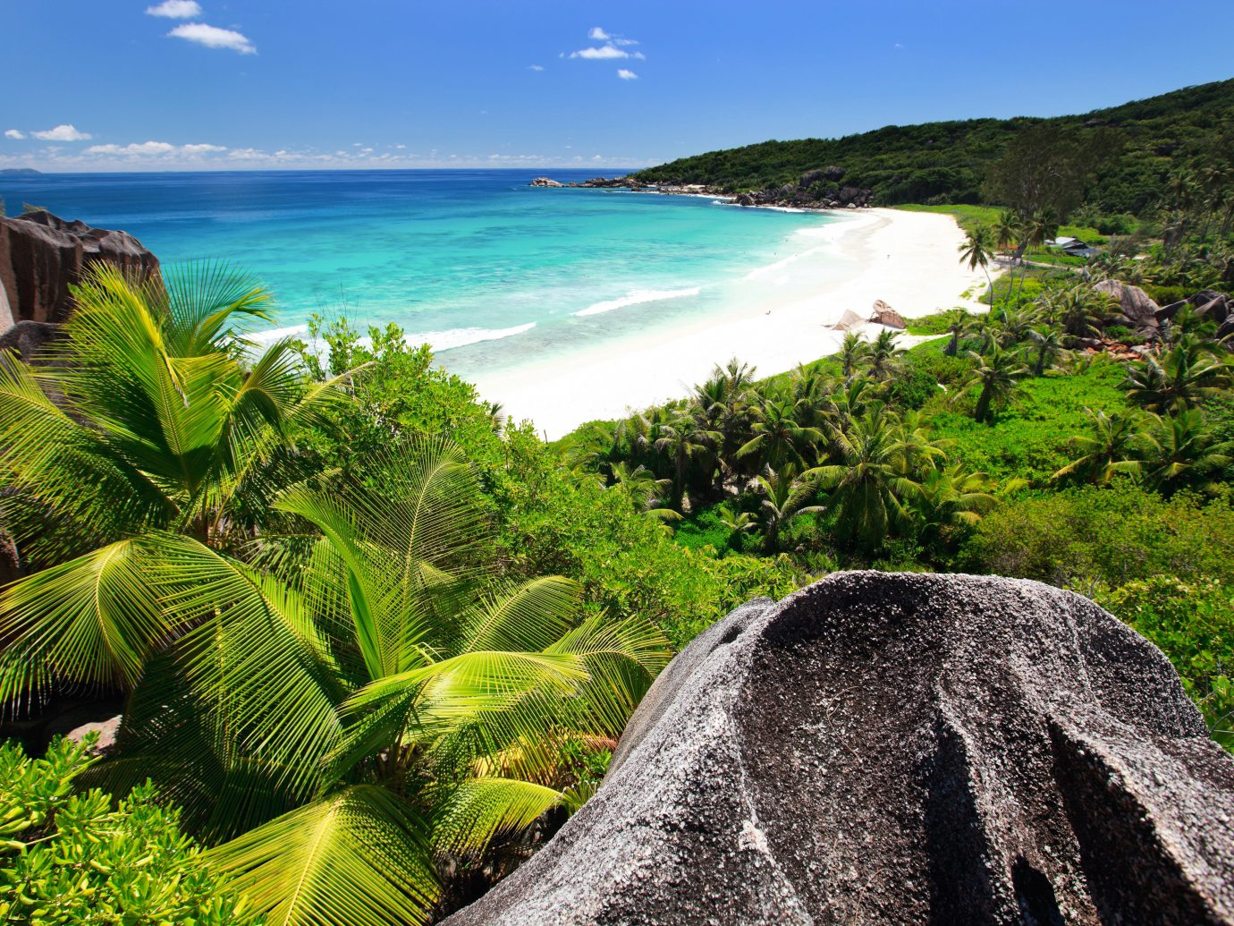 Beach Beachfront Hotels Luxury Ocean Tropical sky outdoor water Nature geographical feature landform Coast body of water Sea tropics vacation rock caribbean Jungle bay landscape arecales rainforest overlooking cape terrain plant beautiful