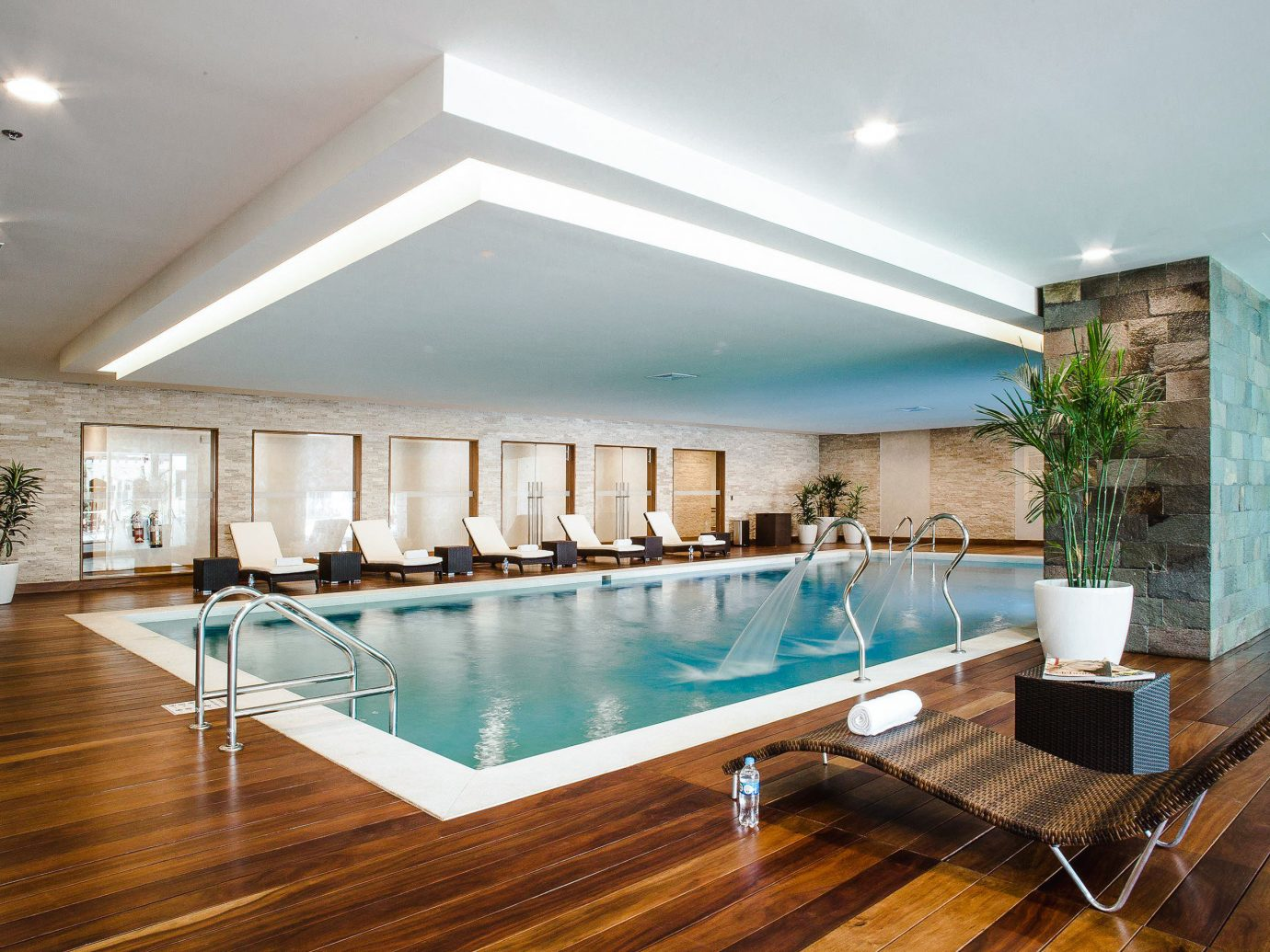 Boutique Hotels Hotels indoor floor ceiling wall swimming pool property room interior design real estate estate apartment condominium daylighting leisure penthouse apartment home house leisure centre window flooring Resort amenity Lobby wood furniture area Island