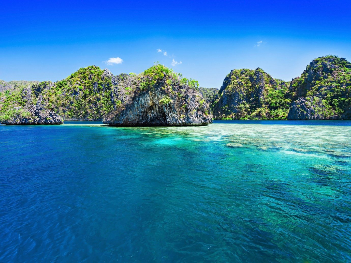 Scuba Diving + Snorkeling Trip Ideas water sky outdoor Nature geographical feature landform body of water Sea reef blue archipelago Coast bay islet Ocean Beach Lagoon shore Island caribbean tropics cove cape surrounded swimming day