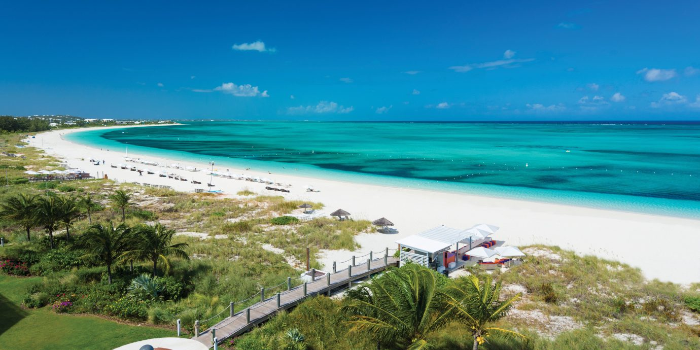 Beach Beachfront Exterior Grounds Hotels Ocean Outdoors Play Scenic views Trip Ideas sky grass water outdoor Nature shore Coast Sea horizon vacation caribbean bay cape cove Lagoon islet swimming pool