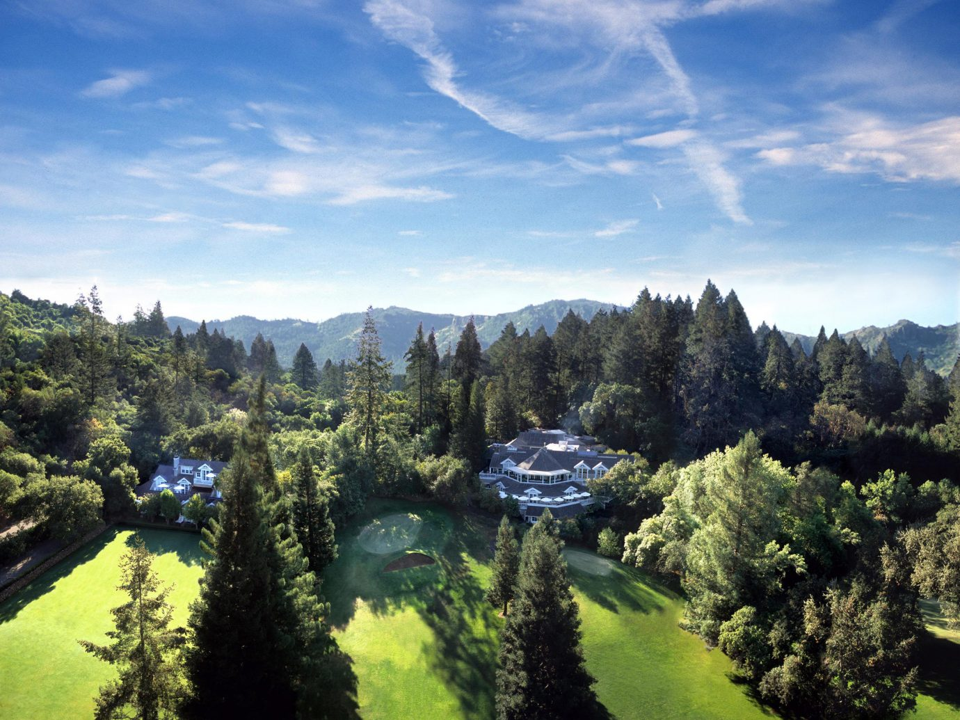 Health + Wellness Hotels Spa Retreats tree outdoor sky mountainous landforms plant Nature mountain wilderness ecosystem mountain range cloud Lake Forest reflection hill landscape valley alps ridge wooded Garden hillside lush day