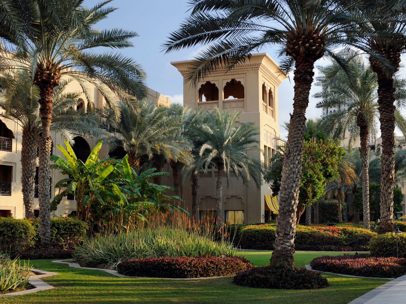 Dubai Elegant Exterior Garden Grounds Hotels Luxury Luxury Travel Middle East Modern Resort tree outdoor grass street property house estate plant home vacation arecales mansion Courtyard Villa hacienda palace residential palm bushes