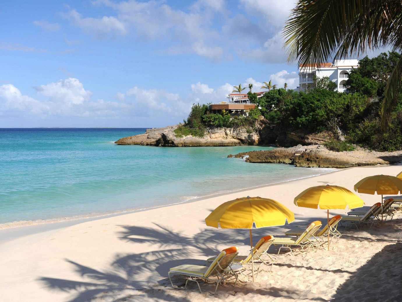 Trip Ideas outdoor water sky Beach umbrella chair shore Sea lawn body of water Nature vacation caribbean Ocean Coast lined bay tropics Resort Island sand cape Lagoon cove palm sandy swimming line