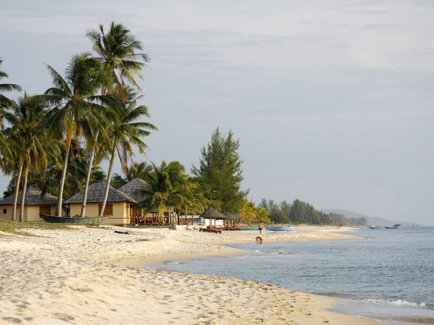 Lakes + Rivers Landmarks Romantic Getaways outdoor tree Beach sky water shore body of water Nature Sea Coast Ocean vacation arecales palm sand bay walkway cape sandy tropics lined distance