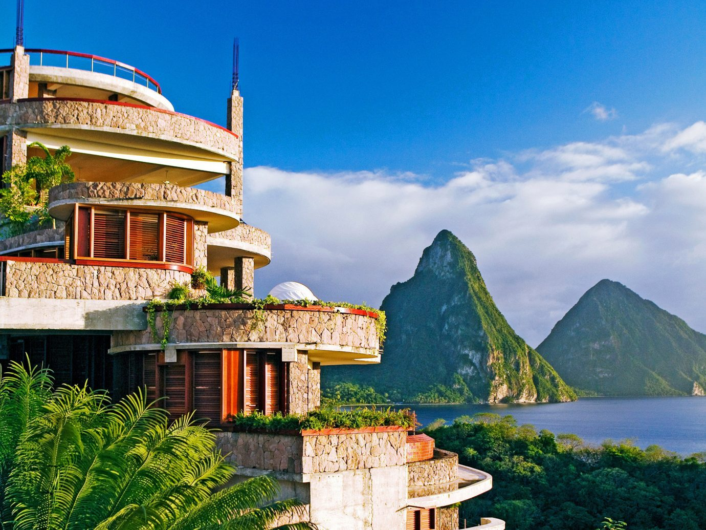 Buildings Exterior Hotels Island Luxury Luxury Travel Outdoors Romance Scenic views Trip Ideas sky outdoor landmark Town building vacation house tourism estate Village monastery Resort cityscape travel palace place of worship