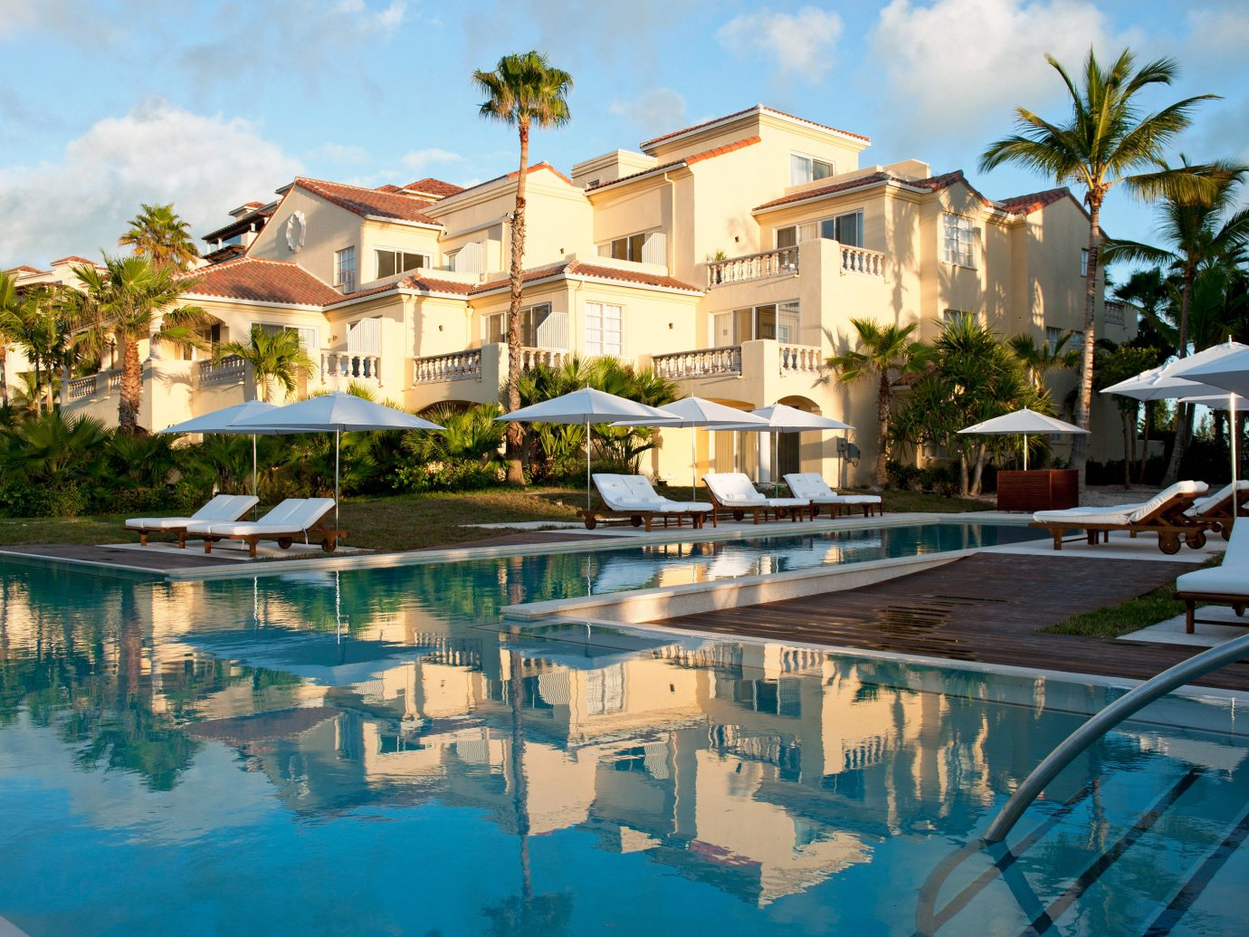 Buildings Grounds Hotels Luxury Pool Romance Scenic views Trip Ideas outdoor building sky swimming pool property Resort leisure estate vacation condominium house home resort town Villa mansion real estate marina Village area several