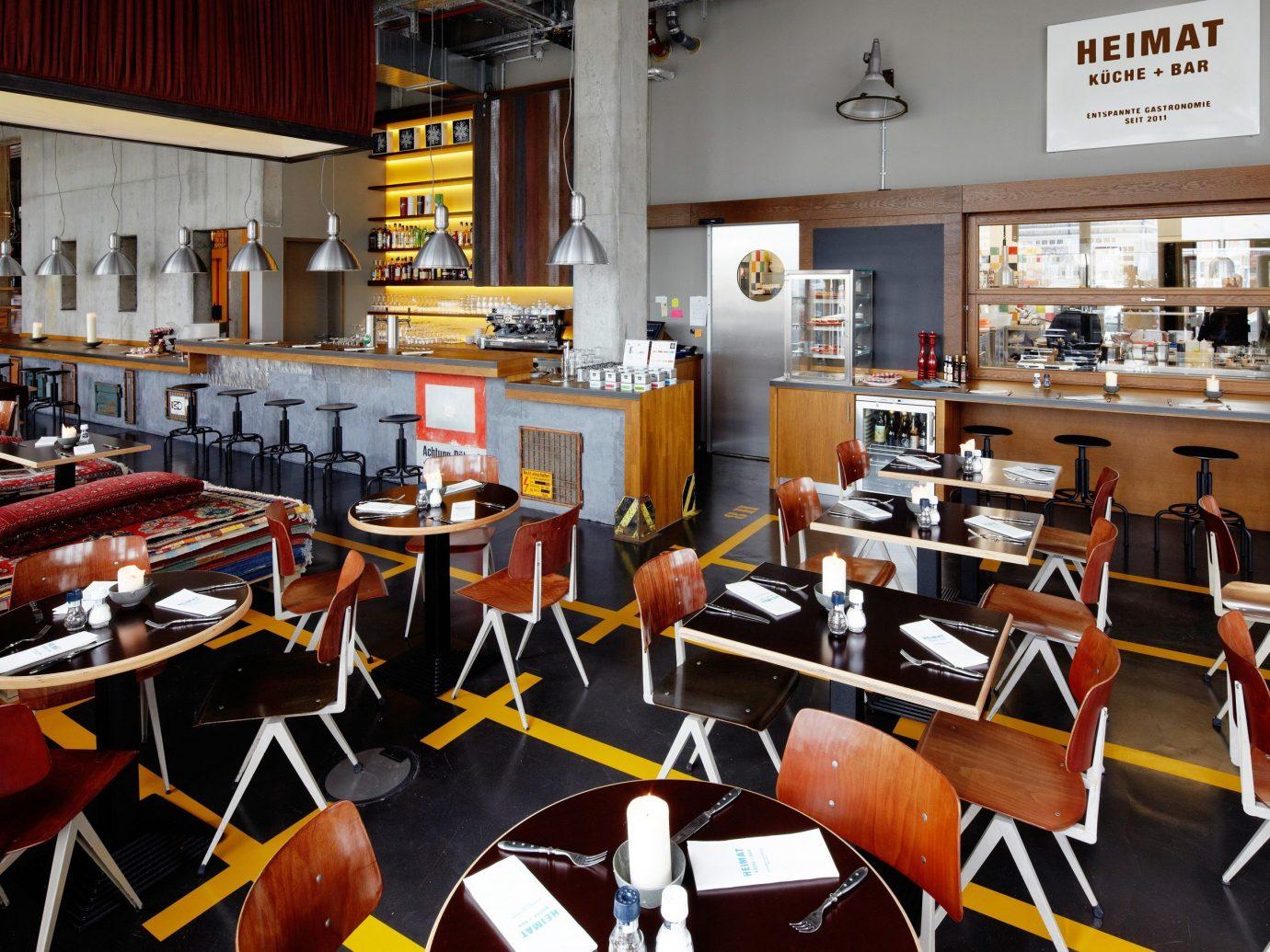 Food + Drink indoor table floor chair Kitchen room restaurant interior design Design Dining meal area furniture cluttered