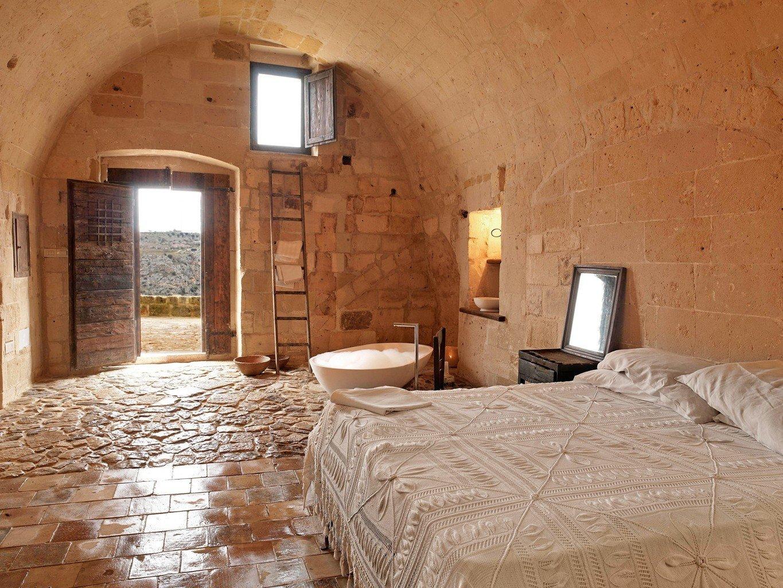 Hotels Offbeat indoor wall bed room property building estate floor cottage farmhouse home wood interior design Villa Bedroom furniture stone