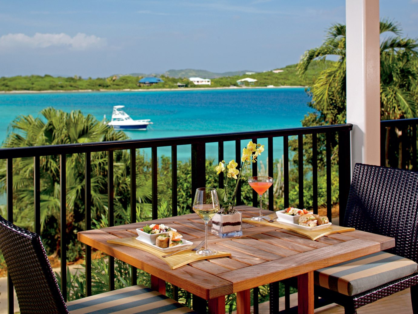 Hotels Romance table sky water outdoor leisure property Resort estate vacation Villa wooden swimming pool cottage real estate home caribbean backyard overlooking Deck