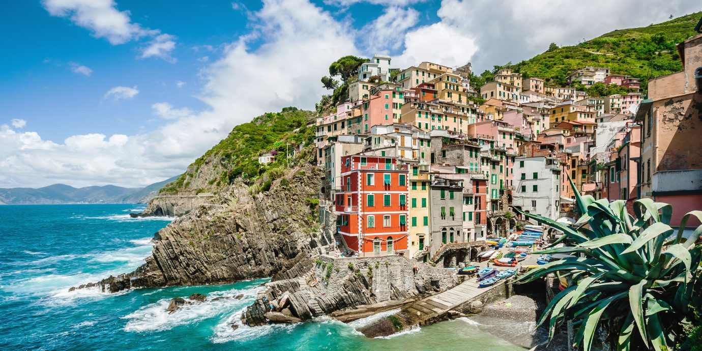 Budget Hotels Trip Ideas outdoor sky water Nature Sea geographical feature Coast body of water Town vacation Ocean tourism Beach caribbean bay cape cliff tropics terrain cove Island shore surrounded rock