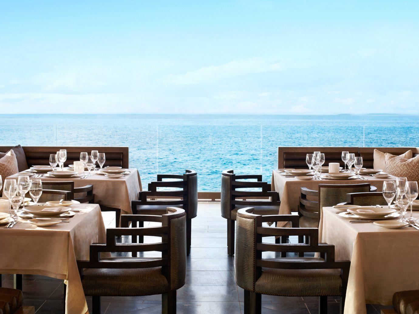 Bar Beach Beachfront Dining Drink Eat Ocean Trip Ideas sky water table chair restaurant passenger ship yacht vehicle meal estate Resort Boat luxury yacht overlooking