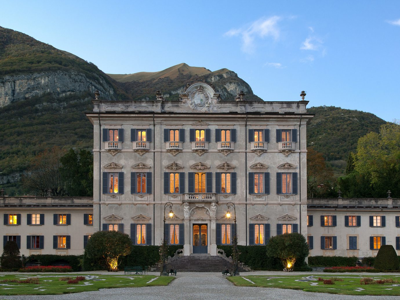 Hotels Luxury Travel sky outdoor mountain landmark building estate stately home château palace mansion national trust for places of historic interest or natural beauty facade Villa old house historic site window real estate tree manor house ancient history elevation Town stone