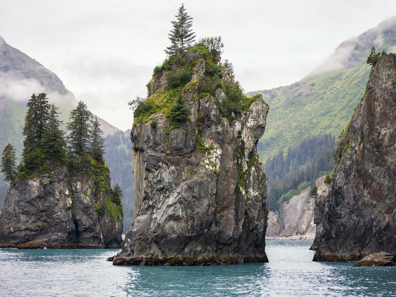 Natural wonders Offbeat Scenic views mountain outdoor water Nature rock landform geographical feature cliff Coast Sea bay terrain rocky background fjord cape stack formation cove islet material surrounded hillside Island distance