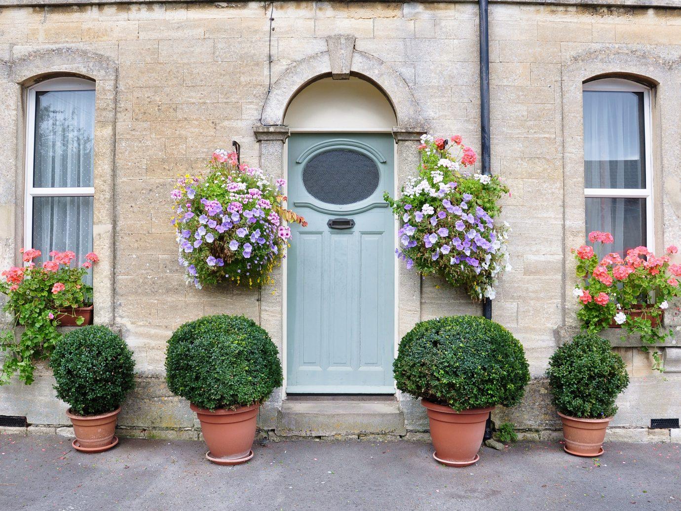 Offbeat outdoor building man made object flower green Garden plant stone home Courtyard facade door window yard arch bushes